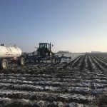 painting the snowy field with black lines using the anhydrous bar
